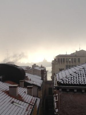 Snow on the rooftops of Venice, views through to the Grand Canal